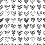 Hand drawn seamless pattern with doodle hearts Stock Photo