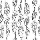 Hand drawn seamless pattern with feathers, vector texture for handmade design. Royalty Free Stock Photo