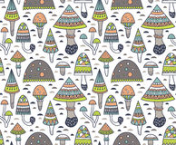 Hand drawn seamless pattern with geometric ornamental mushroom and toadstools. Vector illustration. Royalty Free Stock Photography