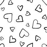 Hand drawn seamless pattern with hearts isolated on white. Hand drawn seamless pattern isolated on white. Endless vector primitive background with black hearts Royalty Free Stock Photo
