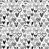 Hand drawn seamless pattern with hearts. Wedding background. Doodle design elements. Vector illustration Stock Photos