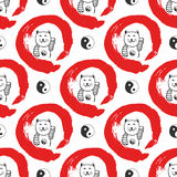 Hand drawn seamless pattern with Japan fortune maneki-neko cats. Yin yang background for design. Red zen circle hand-drawn with in Stock Photography