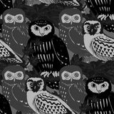 Hand drawn seamless pattern with owls. Black and white doodle birds drawn on the tile texture. Template for wrapping, scrapbook paper, web background and Royalty Free Stock Image