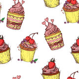 Hand drawn seamless pattern - Sweet cupcakes. Sketch background. Vector Royalty Free Stock Photos