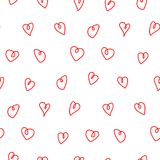 Hearts seamless pattern. Hand drawn seamless vector pattern with red hearts doodles on a white background. Design concept for Valentines day, kids textile print Royalty Free Stock Images