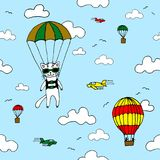 Hand-drawn seamless vector pattern with skydiver cat, air baloon, planes and clouds. Design concept for kids textile print Royalty Free Stock Images