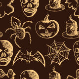 Hand drawn set of halloween attributes, beige sketch on a brown background Royalty Free Stock Photos