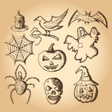 Hand drawn set of halloween attributes, brown sketch on beige background Royalty Free Stock Photo