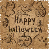 Hand drawn set of halloween attributes, brown sketch on kraft paper Royalty Free Stock Photo