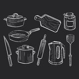 Hand drawn set of kitchen utensils on a chalkboard. Background Stock Image