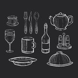 Hand drawn set of kitchen utensils on a chalkboard. Background Royalty Free Stock Photo