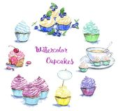 Hand drawn set of watercolor cupcakes. On white background Stock Images