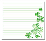 Hand drawn shamrock on white note paper Stock Photos
