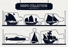 Hand drawn ship silhouettes set  in bottles. Royalty Free Stock Image