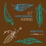Hand drawn silhouettes of feathers in different color. Boho style. Vector illustration Royalty Free Stock Photos