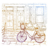 Hand drawn sketch of bicycle on the street, old town Stock Images