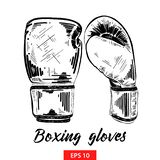 Hand drawn sketch of boxing gloves in black isolated on white background. Detailed vintage etching style drawing. stock illustration