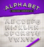 Hand drawn sketch font. On a school squared notebook paper stock illustration