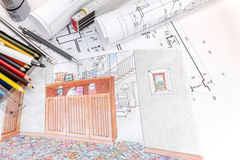 Hand drawn sketches and blueprint rolls for modern room interior Stock Image