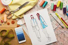 Hand drawn sketches for new fashion collection. Creating new fashion collection background. Hand drawn sketches of clothes, smartphone with color swatches on Royalty Free Stock Image