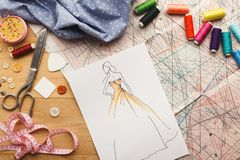Hand drawn sketches for new fashion collection. Dressmaking and fashion collection background. Drawn sketches, sewing patterns and various designer accessories Stock Photography