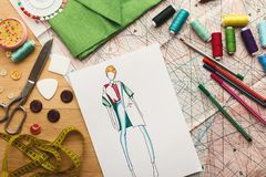 Hand drawn sketches for new fashion collection. Dressmaking and fashion collection background. Drawn sketches, sewing patterns and various designer accessories Royalty Free Stock Photos