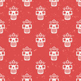 Hand drawn skull with flowers growing through it seamless pattern. Illustration of eternal life in traditional Mexican art style. Hand drawn skull with flowers Stock Photography