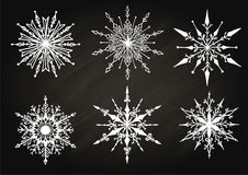 Hand drawn snowflakes on chalkboard for design element. Stock Image