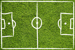 Hand drawn soccer field. Hand drawn (sketch style) soccer field or football field on sunny green grass background Stock Photos