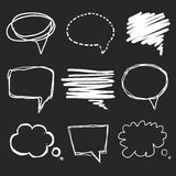 Hand drawn speech bubbles chalk on blackboard Royalty Free Stock Images