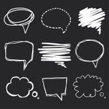 Hand drawn speech bubbles chalk on blackboard Royalty Free Stock Images