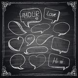 Hand drawn speech bubbles chalkboard effect. Royalty Free Stock Photos
