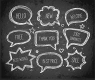 Hand-drawn speech and thought bubbles hand drawn with white chalks on blackboard background. Vector sketch illustration Stock Images