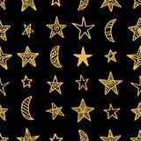 Hand drawn star doodles seamless pattern in gold color on black background Stock Images