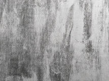 Hand drawn subtle grunge texture. Close-up of vintage background with black brushstrokes on gray wall. Hand drawn subtle grunge texture Royalty Free Stock Images