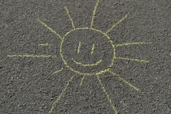 Hand drawn sun on a road. Chalk sketch of sun on a sidewalk road stock illustration
