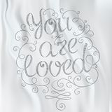 Hand drawn text lettering. You are loved Stock Photography