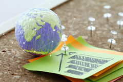 hand drawn texture globe with pin and business graph sticky note Stock Photo