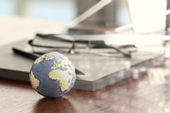 Hand drawn texture globe on wood table near note book Stock Photography