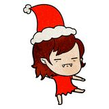 Hand drawn textured cartoon of a undead vampire girl wearing santa hat. A creative textured cartoon of a undead vampire girl wearing santa hat vector illustration