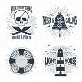Hand drawn textured vintage badges set. Hand drawn textured vintage badges set with pirate skull, bell, lifebuoy, lighthouse, and inspirational lettering Stock Images