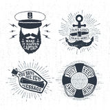 Hand drawn textured vintage labels set with vector illustrations. Hand drawn textured vintage labels set with captain, anchor, lifebuoy, letter in a bottle Royalty Free Stock Photo