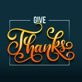 Hand drawn thanksgiving greeting card Give Thanks. Thanksgiving Day card with lettering on blue background with orange lettering and square Royalty Free Stock Photography