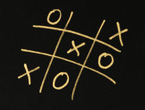 Hand-drawn tic-tac-toe game over black Royalty Free Stock Image