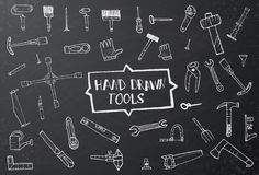 Hand drawn tool icons set on black chalk board Royalty Free Stock Photography