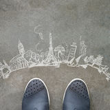 Hand drawn traveling around the world. On front of business man feet as concept royalty free stock photography