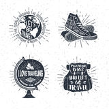 Hand drawn travelling labels set with globe, sneakers, backpack vector illustrations. Hand drawn textured vintage labels, retro badges set with globe, sneakers Royalty Free Stock Photo