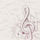 Hand drawn treble clef and notes. On vintage paper Stock Images