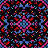 Hand drawn tribal seamless pattern. Hand drawn colorful tribal seamless pattern on black background Royalty Free Stock Images