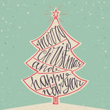 Hand drawn typographic poster. Merry Christmas and Happy New Year background. Hand lettering for christmas. Doodle christmas tree. Stock Photo